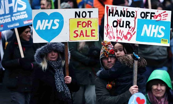 Protestors march against NHS privatisation