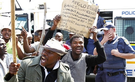 Miners in South Africa demand better pay and conditions from Anglo American