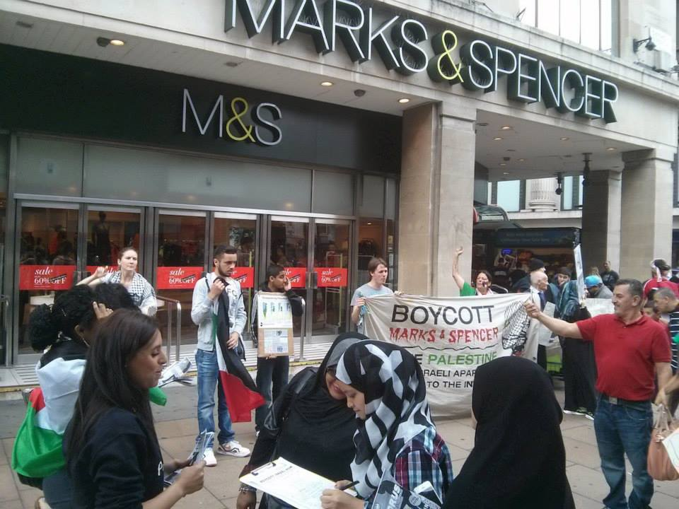 Protesters outside one of the targets, M&S