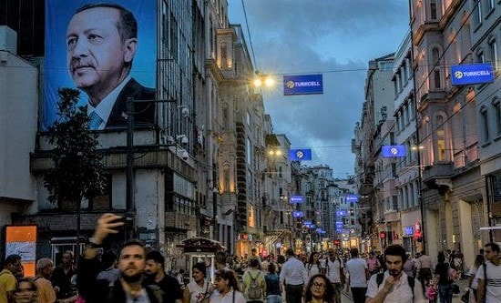 Istanbul high street with poster of Erdogan