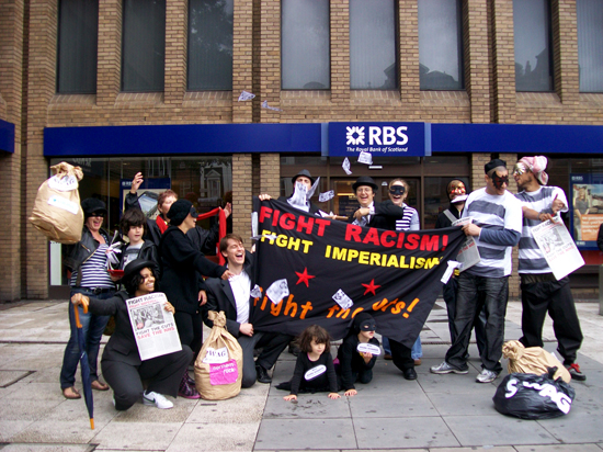 Bank robbers demonstrate against the cuts in Angel - London - 16 July 2011
