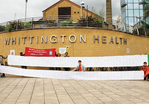 Campaigners unfurl their huge petition outside Whittington Hospital