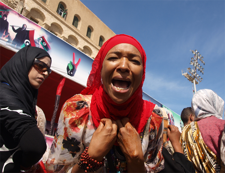 Black Libyan African woman protests at treatment by the NTC in Tripoli's Martyr's Square